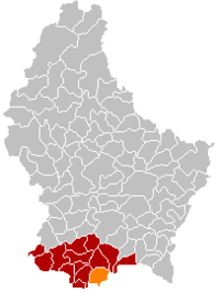 Map of Luxembourg with Dudelange highlighted in orange, the district in dark grey, and the canton in dark red