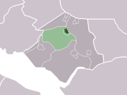 The village centre (darkgreen) and the statistical district (lightgreen) of Abbenbroek in the municipality of Bernisse.