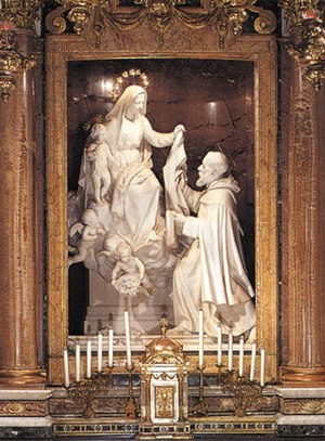 Rosary and scapular - Statue of the Virgin Mary giving the Scapular to St. Simon Stock, Santa Maria della Vittoria Basilica, Rome, by Alfonso Balzico, 19th century