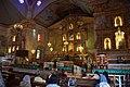 Mass in progress inside Baclayon church (9277955458).jpg