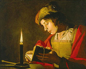 Matthias Stom - Young man reading by  candlelight by Matthias Stom