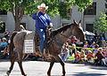 Michael J. Carey rides at Cheyenne Frontier Days Parade.jpg