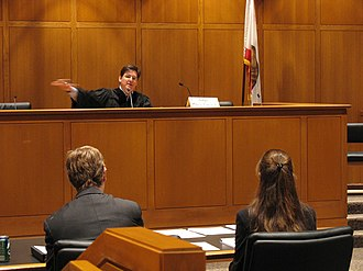 Trial - A trial in the United States. The judge is seated at the front of the room.