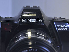 Minolta Dynax 7000i Analogue Film Camera, With Sigma 28-70mm Lens (8744272282).jpg