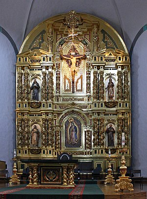 "Mission Basilica San Juan Capistrano - The ""Grand Retablo"" with the Trinity at top center, St. Junípero Serra top left, St. Kateri Tekakwitha top right, St. Francis bottom right, St. Joseph bottom left and Our Lady of Guadalupe bottom center"