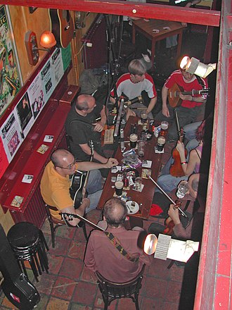 Pub session - Irish music enthusiasts gather at a pub to play music and drink beer