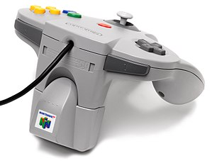 Rumble Pak - A Nintendo 64 controller with the Rumble Pak attached