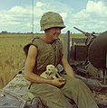 NARA 111-CCV-333-CC33159 1st Infantry Division soldier holding puppy while sitting on M113 Operation Buckskin 1966.jpg