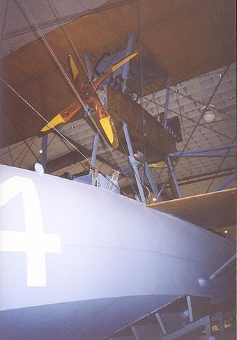Center nacelle pusher and 4 bladed tractor Liberty V-12 engines, the Herreshoff hull, and one wing of the NC-4 in the National Museum of Naval Aviation, Pensacola, in 1997. NC4EnginePensacola.jpg