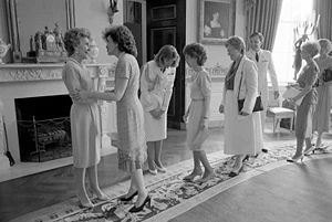 Elizabeth Dole - First Lady Nancy Reagan greets Dole and other Senate wives in the Blue Room. 1988