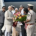 Narendra Modi being received by the Governor of Goa, Smt. Mridula Sinha, the Chief Minister of Goa, Shri Laxmikant Parsekar and the Union Minister for Defence, Shri Manohar Parrikar, on his arrival in Goa (2).jpg