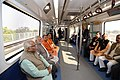 Narendra Modi taking a ride in Metro from Botanical Garden Station to Okhla Bird Sanctuary along with the Governor of Uttar Pradesh, Shri Ram Naik and the Chief Minister, Uttar Pradesh.jpg