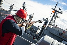 220px Navy Petty Officer fires a line to the USNS Supply in the Baltic Sea