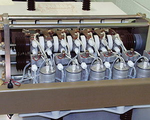 Nelson River DC Transmission System - The Bipole 2 thyristor valves: Six parallel-connected pairs of thyristors in a module, with cooling piping and voltage grading capacitors.