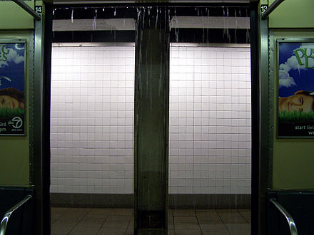 Rain from drainage pipes comes into a subway car New York City Subway 100 1888 edited.JPG