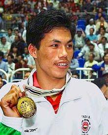 https://upload.wikimedia.org/wikipedia/commons/thumb/3/34/Ngangom_Dingko_Singh_at_the_13th_Asian_Games.jpg/220px-Ngangom_Dingko_Singh_at_the_13th_Asian_Games.jpg
