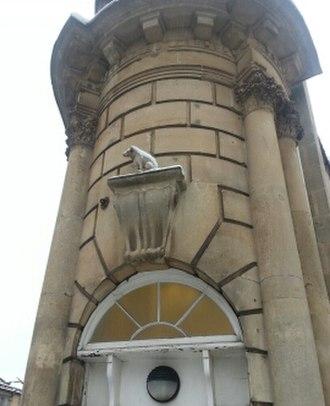 Nipper - Nipper above a doorway of the Merchant Venturers Building in Bristol