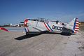 North American SNJ-3 Texan BuNo 786987 N7648E GEICO Skytypers 4 LSideRear TICO 16March2014 (14642643176).jpg