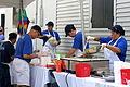 Oak Street Po-Boy Festival 2011 Serving It Up.jpg