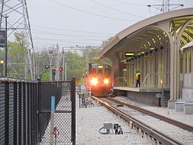 Oakton CTA platform with train.jpg