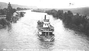 Steamboats of the Columbia River, Wenatchee Reach - ''Okanogan'' coming downstream on the Okanogan River, circa 1910