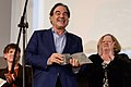 Oliver Stone receiving Wild Dreamer Award.jpg
