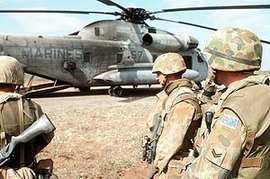 Australian soldiers prepare to board a United States Marine Corps helicopter in Somalia
