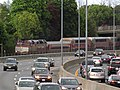 Outbound train and Mass Pike at Auburndale.JPG