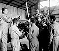 "PILOT TRAINEES DURING A LESSON ON THE AIRCRAFT ENGINE AT THE KATZ (PALESTINE FLYING SERVICE) FLYING SCHOOL IN LOD. קורס טיס בבית הספר לטיסה ""כץ"" בלוד.D393-014.jpg"