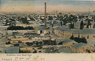 Energy in South Africa - A postcard photograph circa 1907 of the Kimberley Municipal Compound.  The Kimberley Power plant with its tall chimney stack opened in 1882 can be seen in the centre of the image.
