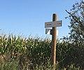 Panneau de randonnées indiquant le Bois Muet à environ 1 km à Beynost (France).JPG