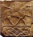 Panneau sculpté cavalier germain.jpg