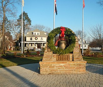 Westwood, New Jersey - Westwood Park Place decorated for the holidays. Notice that the Fire Bell is covered with a Christmas Wreath