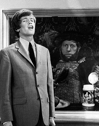 "Peter Noone - As Noone sings ""Henry the VIII"" on The Danny Kaye Show, the king's portrait comes to life."