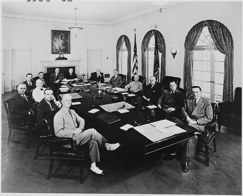 Photograph of President Truman with members of his Cabinet and other officials, in the Cabinet Room of the White... - NARA - 200610