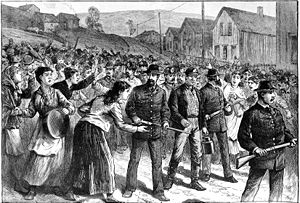Wage slavery - Pinkerton guards escort strikebreakers in Buchtel, Ohio, 1884