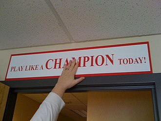 Play Like a Champion Today - The Play Like a Champion Today sign for away games.