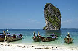 The beach of Poda island with long-tail boats