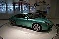 Porsche 911 1997 Carrera 3.4 Coupè-gepanzert RSideFront PorscheM 9June2013 (15012640875).jpg
