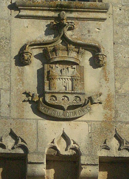"""Heraldry on top of the castle gate in Jonzac. The caption  """"POST BELLA OTIA PACIS"""" means """"After the wars, the leisures of peace."""""""