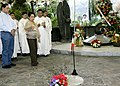 President Gloria Macapagal-Arroyo sprinkles holy water to the tomb of her late father.jpg
