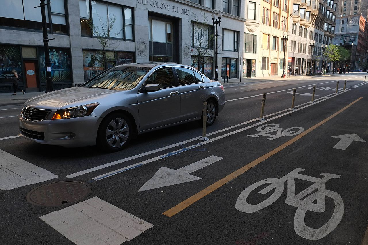 1280px-Protected_Bike_Lanes_%2826946261056%29
