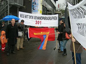 "Article 301 (Turkish Penal Code) - Demonstration against Article 301 in front of the Turkish Embassy in Germany. The text on the protestor's banner reads: ""Away with this shameful paragraph!"""