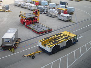 Pushback - Photo shows a pushback tug carrying a towbar on apron.