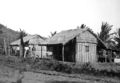 Queensland State Archives 1385 Huts built from palm leaves and roofed with grass Palm Island c 1935.png