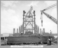Queensland State Archives 3614 Main bridge erection stage 3 tower traveller at main pier main posts erected Brisbane 8 February 1938.png
