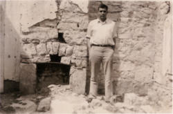 Robert E. Howard in the doorway of a ruined wall