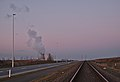 Railway and the Doel nuclear power station cooling tower during sunset civil twilight in Kieldrecht, Belgium (DSCF3913).jpg