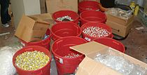 Several large buckets of tens of thousands of Anabolic steroid vials confiscated during a DEA raid.