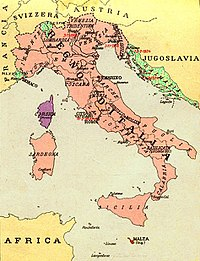 "Map of the regions of Italy held and claimed after the unification process in 1920 in a Fascist-era textbook published in 1935. In color are the areas still ""irredent"": Malta in red, Corsica in purple, Dalmatia in yellow/green, Nice and Ticino in yellow/green."